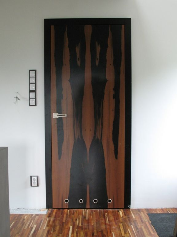 Model: Verticalis Detail: natural veneer White ebony; frame: natural veneer beech + black colour