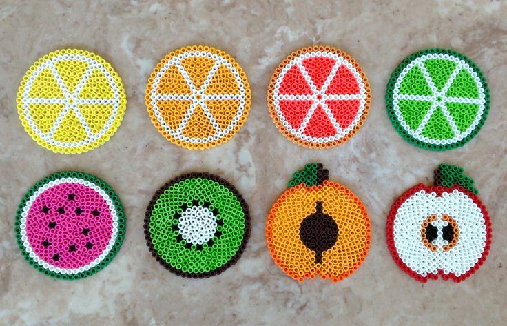 Set of 8 fruit-themed Perler bead coasters - $15.00 (Lemon, orange, pink grapefruit, lime, watermelon, kiwi, peach, apple)  Buy them here! https://www.etsy.com/listing/194440044/set-of-8-fruit-themed-perler-bead