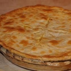 This quick-fix pot pie can be whipped up in minutes and tastes like you spent hours in the kitchen. Cooked, diced chicken breasts are combined with condensed cream of chicken soup and mixed veggies. Pour into a prepared pie shell, cover with a round of pastry, and bake. Makes eight generous servings.