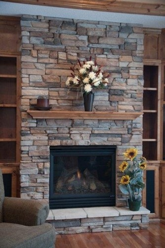 Fireplace idea -- close, but not totally sold on this stone.  Will have bigger mantle than the one shown here.