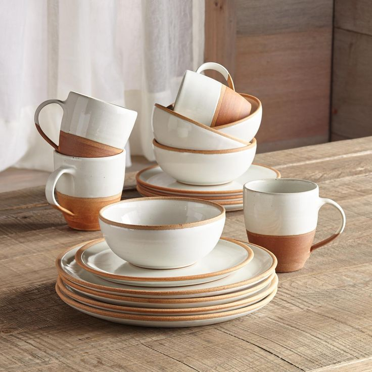 """TERRA DINNERWARE, 16-PIECE SET--Relish in the rustic beauty of this fair trade, artisan-made, raw-edge terracotta and glazed white ceramic dinnerware set. Subtle variations exist due to handmade nature. Dishwasher/microwave safe. Imported. Set includes four each dinner plates (11"""" dia.), salad plates (8"""" dia.), bowls (5-1/2"""" dia.) and mugs (4"""" dia. x 4-1/2""""H) for a total of 16 pieces."""