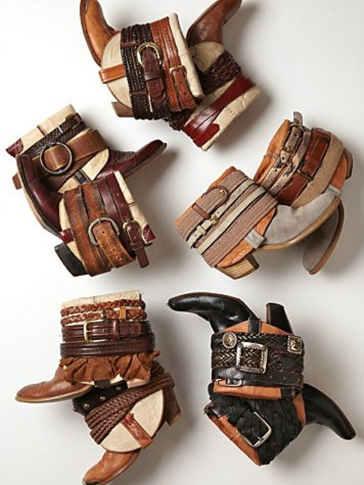 Turned down cowboy boots with assorted leather belts to finish the cuff. Yes please.