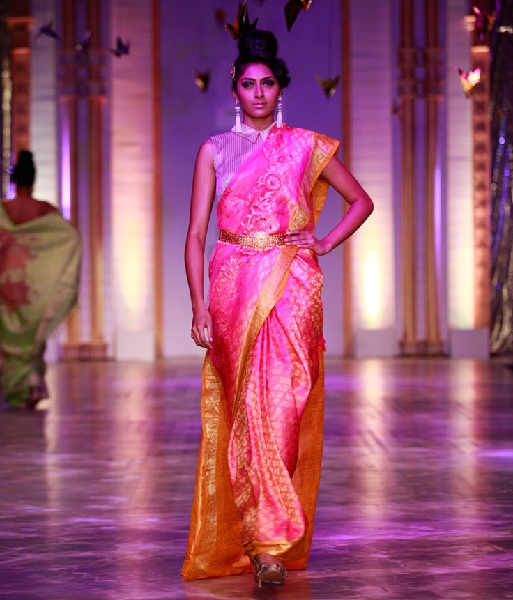 Neeta Lulla A lovely pink net saree embellished with kanjivaram appliqué. The saree sports a golden yellow kanjivaram pallu and matching borders. It is accompanied with a matching blouse piece.