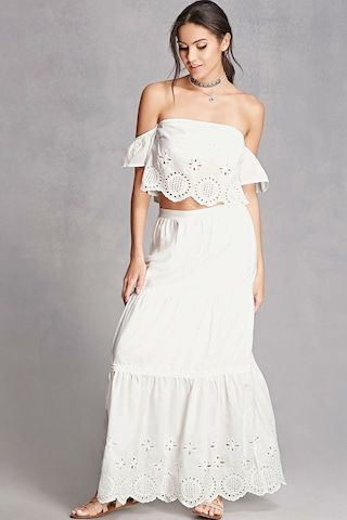 A woven top and skirt set featuring an elasticized ruffle tube top with short sleeves, and a matching skirt with a partially elasticized back, side slip pockets, and a tiered seam construction.  This is an independent brand and not a Forever 21 branded item.