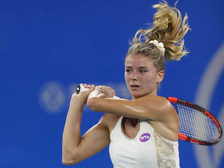 Camila Giorgi of Italy returns a shot during the match against Angelique Kerber of Germany on Day 4 of 2015 Dongfeng Motor Wuhan Open at Optics Valley International Tennis Center in Wuhan, China.  Zhong Zhi, Getty Images
