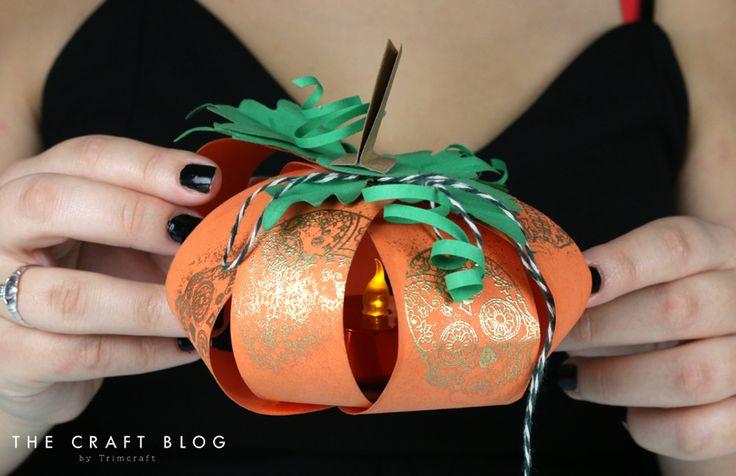 Read Angela Dodson's pumpkin tea light holder tutorial and print her free template