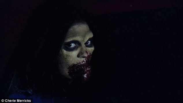 Channelling the undead: The star was transformed into a zombie, with pale green skin and dark blood smeared across her mouth
