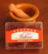 Spanish Saffron - Essential Ingredient in Spanish Food: Spanish Saffron with Miniature Mortar (c) 2006 L. Sierra Licensed to About.com