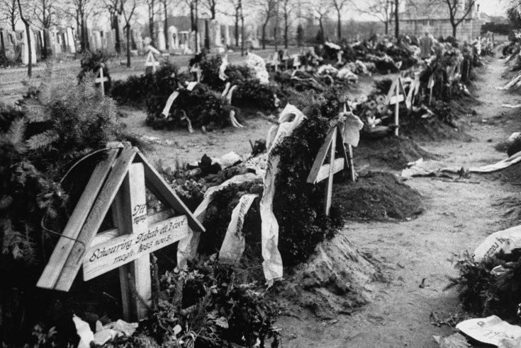 Caption from LIFE. Graves of Hungarian freedom fighters lie in the same cemetery with the Russian dead but are covered with offerings of flowers and wreaths. 19 of 29