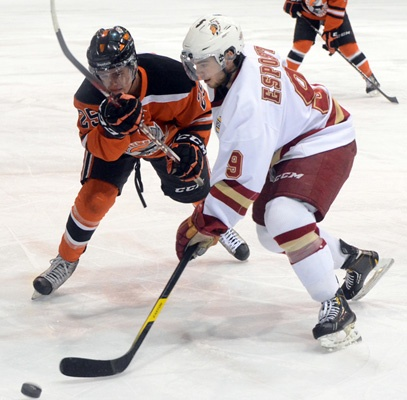 Chiefs forward Luke Esposito battles Nanaimo Clipper Brendan Taylor during Friday's BCHL game.