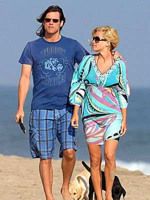 Jim Carrey & Jenny Mccarthy with two puppies