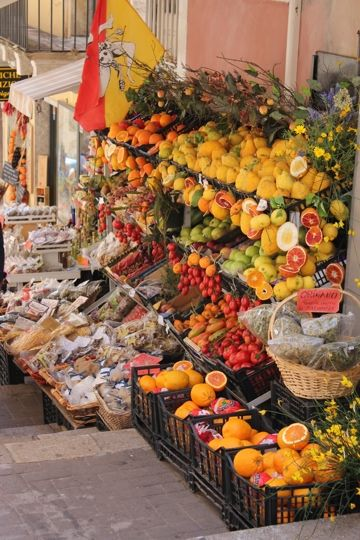 Just off Corso Umberto in Taormina is this fabulous little fruit vendor, province of Messina , Sicily