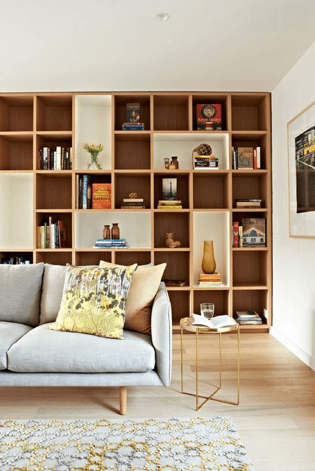 White And Wood Shelves - A wall of shelving maximizes storage and complements design