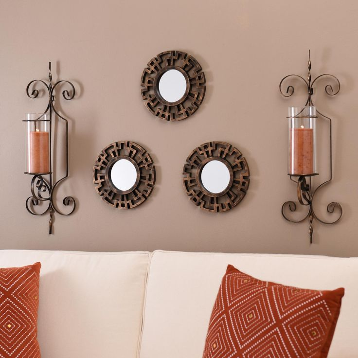 This set of Greek Key Framed Mirrors adds a unique style to your home with geometric figures.