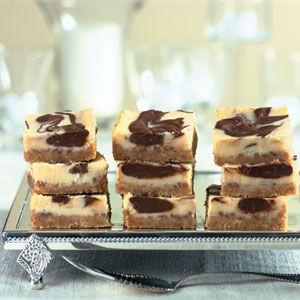 Eggnog recipes spread creamy holiday cheer, as revealed in these cheesecake brownie bars. A buttery crust of vanilla wafers and toasted pecans balances the rich chocolate filling that's flavored with a splash of rum flavoring.