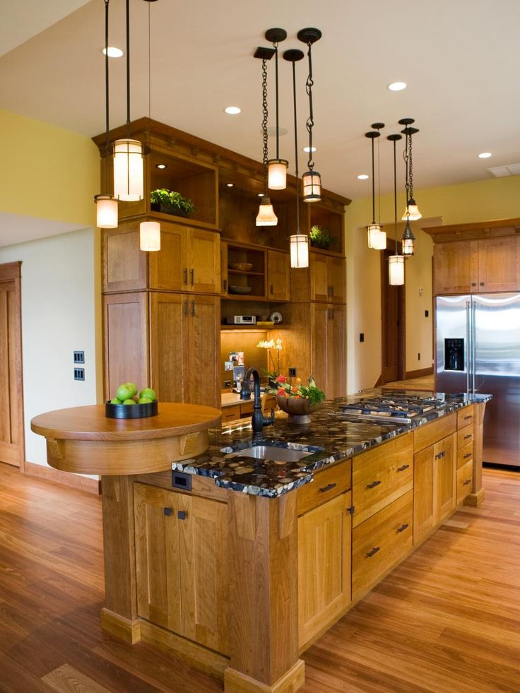 A large island anchors this craftsman designer kitchen. Multiple pendant lights dress up the space while providing task lighting for easy meal prep.