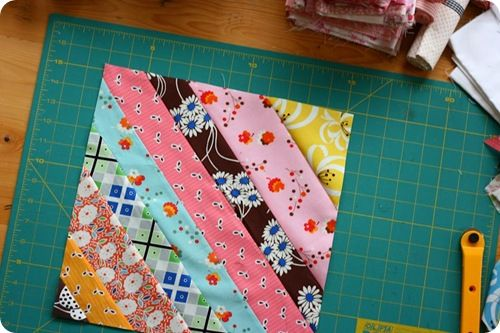 This Cute quilt block gives me the idea to do big strips across the whole thing instead of small blocks. Cute? I really want to make a quilt