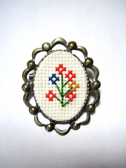 """Bouquet pin, brooch or necklace from his mom or grandma for the """"something borrowed."""""""