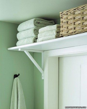 Put a shelf above your bathroom door to store bulky items like towels. Great for a place with limited storage!