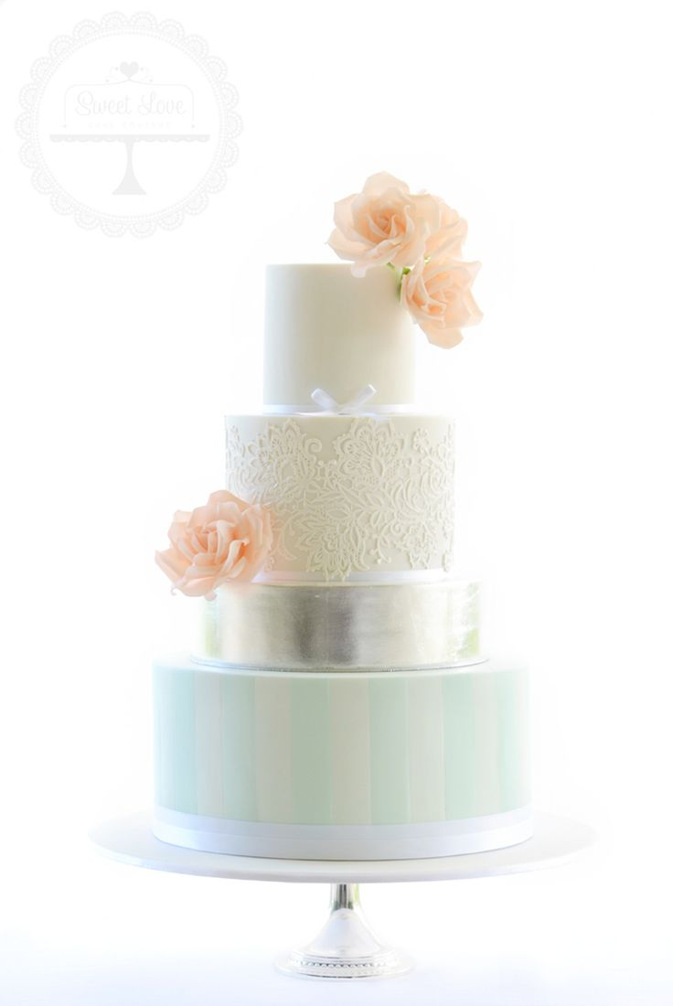 Exquisite wedding cake with mint stripes, edible silver leaf, lace and sugar roses