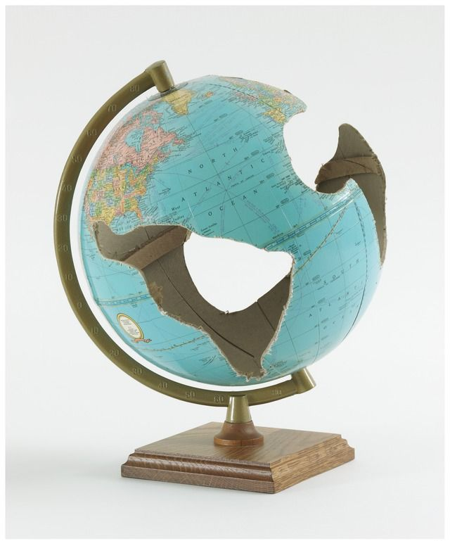 """cardboard globe with wooden base, 12"""" x 9"""" x 9"""" (30.5 cm x 22.9 cm x 22.9 cm), 1994, © Fred Wilson, courtesy Pace Gallery / Photo by: Kerry Ryan McFate, courtesy Pace Gallery"""