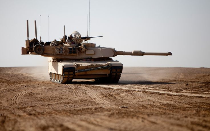 U.S. Marines with 1st Marine Division, 1st Tank Battalion, Delta Company, navigates the terrain of Helmand province, Afghanistan in an M1A1 Abrams Tank while on a convoy escorted by 1st Marine Logistics Group (Forward) (1st MLG (FWD)), Combat Logistics Battalion 8 (CLB-8) on February 1, 2011. (U.S. Marine Corps/Staff Sgt. Brian A. Lautenslager)