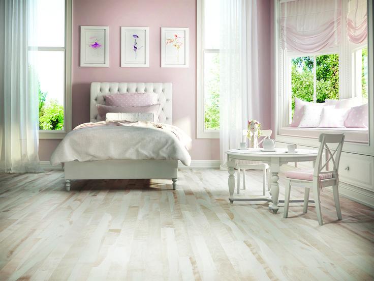 This beautiful girl bedroom features a beautiful shaded Lauzon Camarillo light hardwood flooring. Available with Pure Genius, Lauzon's new air-purifying smart floor #PureGenius #bedroom #airpurifying #smartfloor #interiordesign #homedecor #hardwooflooring #ArtFromNature