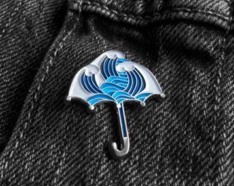 Pins Umbrella and Waves