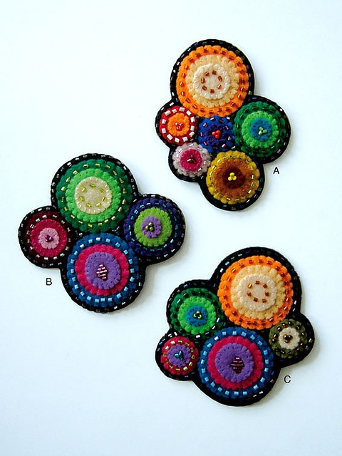 """colored brooches... like this """"random"""" penny arrangement for coasters, etc."""