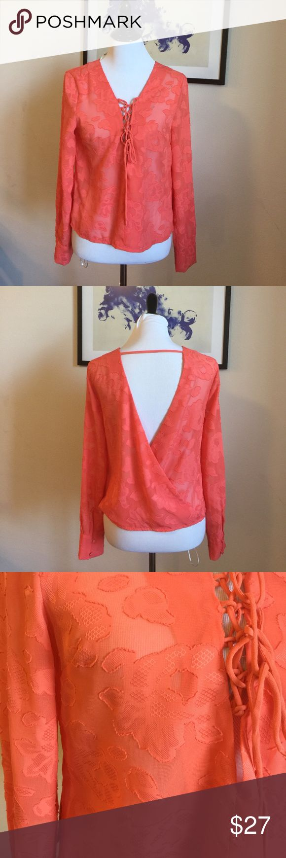 Brand New Miss Me Sheer Luck Blouse NWOT. Directly bought from Miss Me showroom. Brand New and never worn or used. A lace-up neckline, floral pattern, button cuffs, and V-back opening gives this semi-sheer blouse the look of romance! Pretty Coral color, can dress it up with heels or dress it down with a pair of shorts.                    🌟Top Rated seller⚡️Fast shipper😘Willing to negotiate Miss Me Tops Blouses