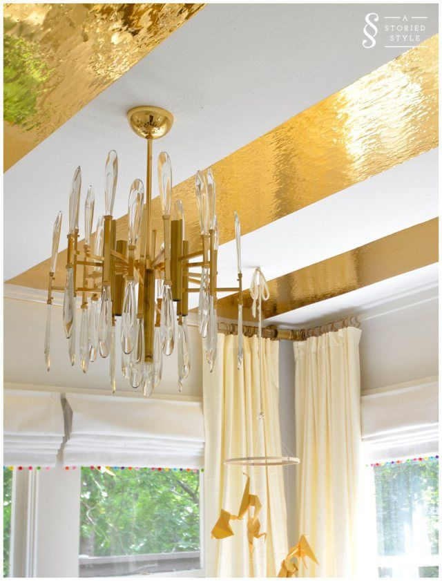 DIY Gold Contact Paper Ceiling Stripes. Maybe a cool idea for the master?
