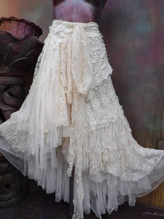 wedding skirt,tatter wedding skirt,tattered skirt, stevie nicks, bohemian skirt, boho skirt, gypsy skirt, lagenlook skirt,OAK, shabby wrap skirt.. she,s an absolutely gorgeous bohemian wrap around shabby skirt in off white hues kissed with assorted bridal laces,netting,rose trims,crochet,butterflies,bridal decals and shabby detail with roses where she ties giving her a shabby chic feel…..these pieces are works of art and sell way below their worth so grab something unique while y..
