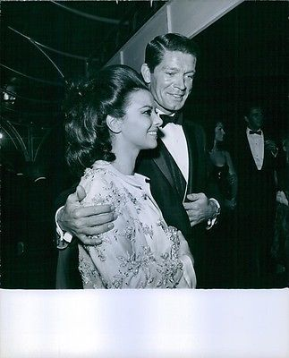 Vintage photo of Actor Stephen Boyd is standing with his Giovanna Ralli