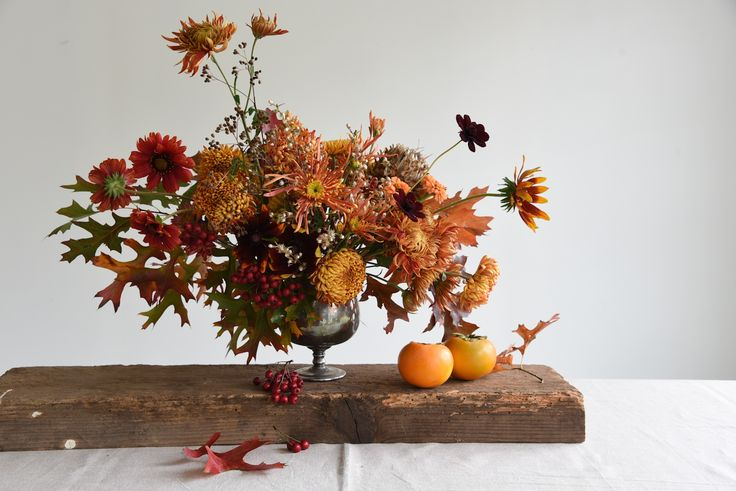 centrepiece, table flowers, fruit, may, autumn, oak leaves, harvest, orange, red, persimmon