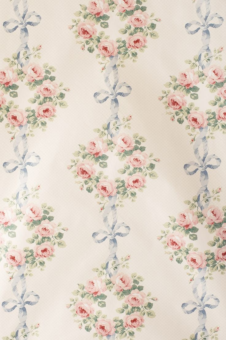"Jean Monro 'Elizabeth' #JM915. 100% Cotton, 54"" wide, 20"" repeat. Late-Victorian design in which circular wreaths of roses hang from knotted bows of ribbons, with an interesting small trellis background, much used in the Victorian era."