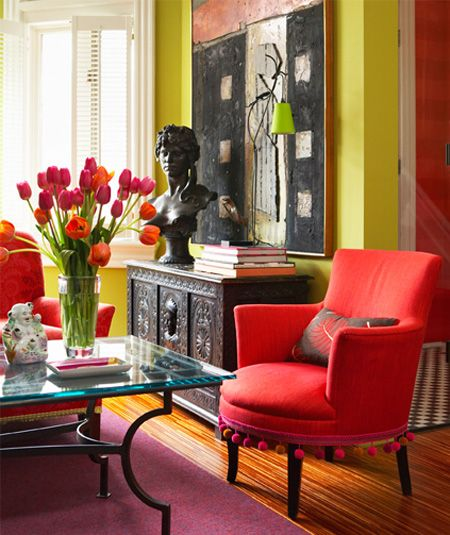 love this bright, funky room...especially the pom pom trim on the chair!!