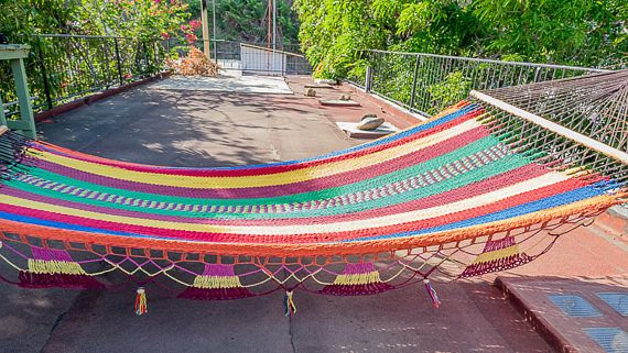 Our Nicaraguan hammocks are works of art. Each hammock is woven by hand the traditional way in Masaya, Nicaragua, and represent days of work. They are unique because they are made with soft spun cotton and they are more tightly woven than any other hammock. The heavy gauge cotton weave is perfect for lounging on a hot day, since it doesn't trap heat. The spreader bars are used to keep the hammock more flat when you lay on it. These beautiful hammocks make the perfect addition to any patio…