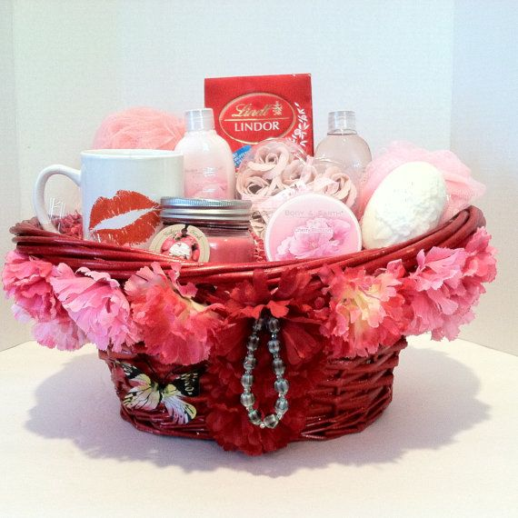 Hot! Ma Ma~Vera Mae Collection  Give her the royal treatment with this luxurious spa gift basket featuring Cherry Blossom   1 Shower Gel 1 Body Lotion 1 Body Scrub 1 Mini Sponge 1 Body Sponge 1 Cup 1 Candle 1 Soap Rose Petals 1 Soap Bar Lindt Lindor Irresistibly Smooth Milk Chocolate Truffles   (This Item Is Sold)