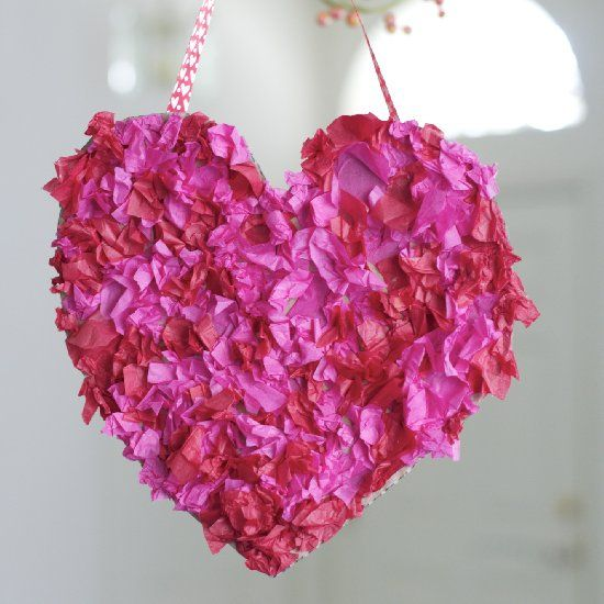 """Spruce up your home with a cute Valentine kids craft. Your little one will """"love"""" making this tissue paper heart wreath!"""