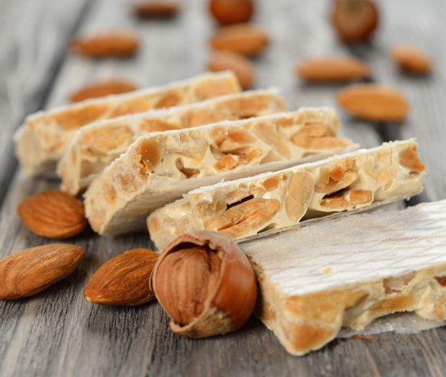 Torrone is made with egg whites, honey, sugar and filled with toasted almonds, hazelnuts or other types of nuts #sorrentofoodtours #Italiandolce #yum