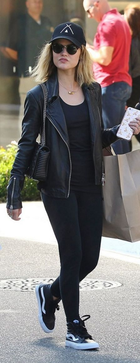 Who made Lucy Hale's sneakers, print leggings, sunglasses, quilted handbag, and leather jacket?