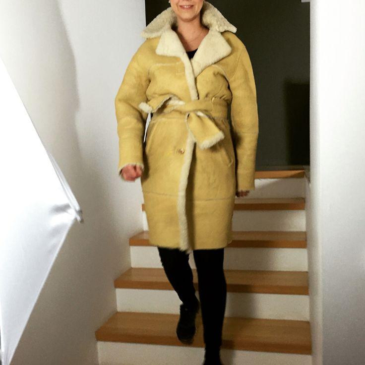yellow reversible sheepskin coat
