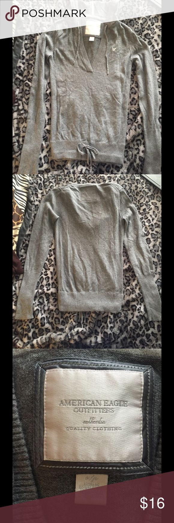 Gray American eagle sweater Really soft gray sweater from American eagle with hood and tie around the bottom, stretchy material American Eagle Outfitters Tops Tees - Long Sleeve