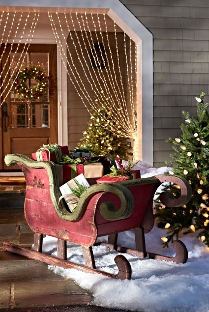 Stack up the gifts in a delightful new way by arranging them in our Artisan Sleigh. Crafted of rustic recycled wood, it looks like an heirloom from great-grandpa's day.
