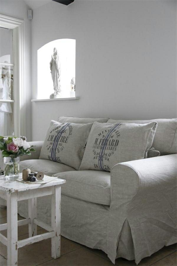 linen couch covers, gray/print pillows, white walls...