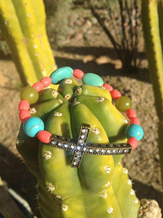 Sideways cross bracelet by AroundMyWrist on Etsy, 10.95