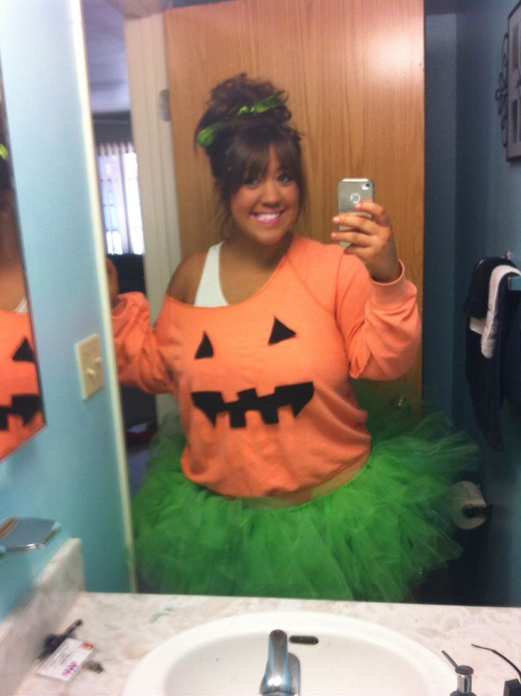 Easiest fastest pumpkin halloween costume ever. Got SOOO many compliments. Orange sweater with taped on black felt and green tool tutu. With green ribbons in hair and black flip flops with orange ribbons taped on and comfy black leggings.
