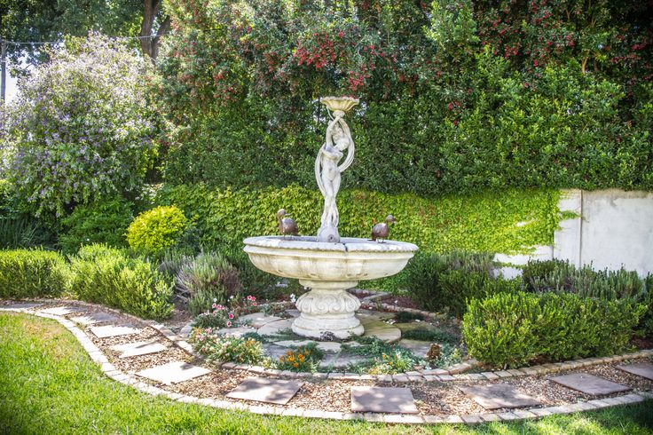 A lovely water feature found in the neat and tidy garden with sizeable lawn,perfect for youngsters and pets.