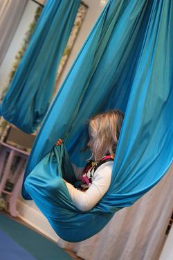love these yoga hammocks for meditation/quiet space/mindfullness - link to article about having a space like this for kids