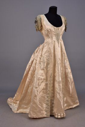 WORTH TRAINED And BEADED SILK BALL GOWN, 1887 - 1890.